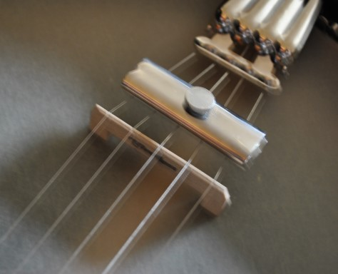 THE CLAMP MUTE. FOR 4 AND 5 STRING BANJOS.